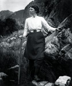 black and white portrait of du Faur on a mountainside, pickaxe in hand