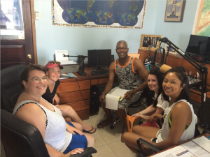 Emma, Hayley, Laura, and Mandy at the Lighthouse Radio interview with Clive, advertising for camp and discussing some important issues facing the reef