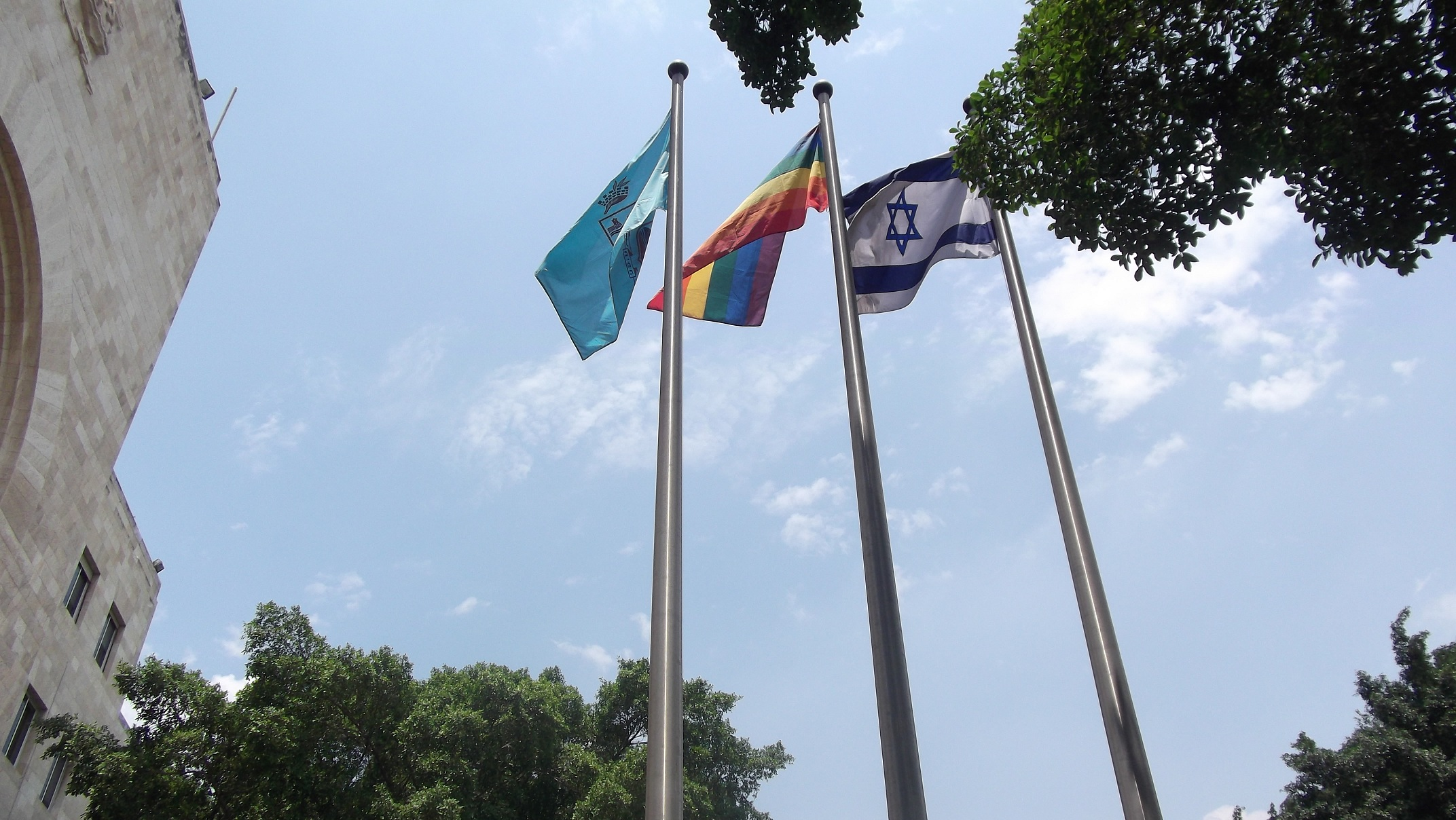 When the March reached City Hall a man went up to raise the rainbow flag in between the flags for Israel and Haifa resulting in huge cheers all around