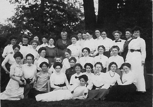 image of a group of women in white seated and standing.