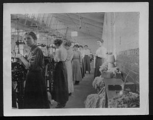 image of women working at machines in a textile factory