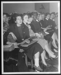 black and white photograph of women sitting in rows at the first national Y-Teen confernece