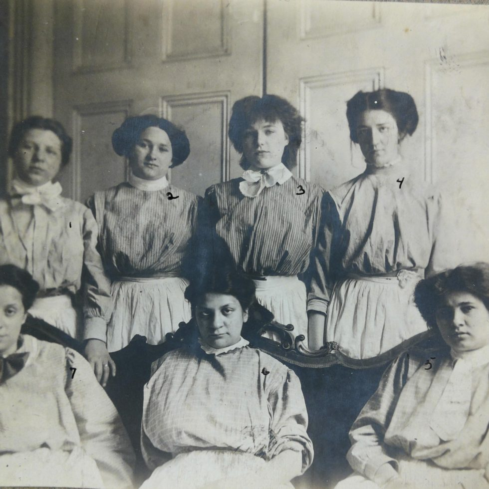Image of a group of girls looking into the camera. There are hand-drawn numbers on each person.