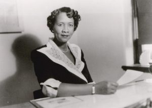 Dorothy Height sits at desk