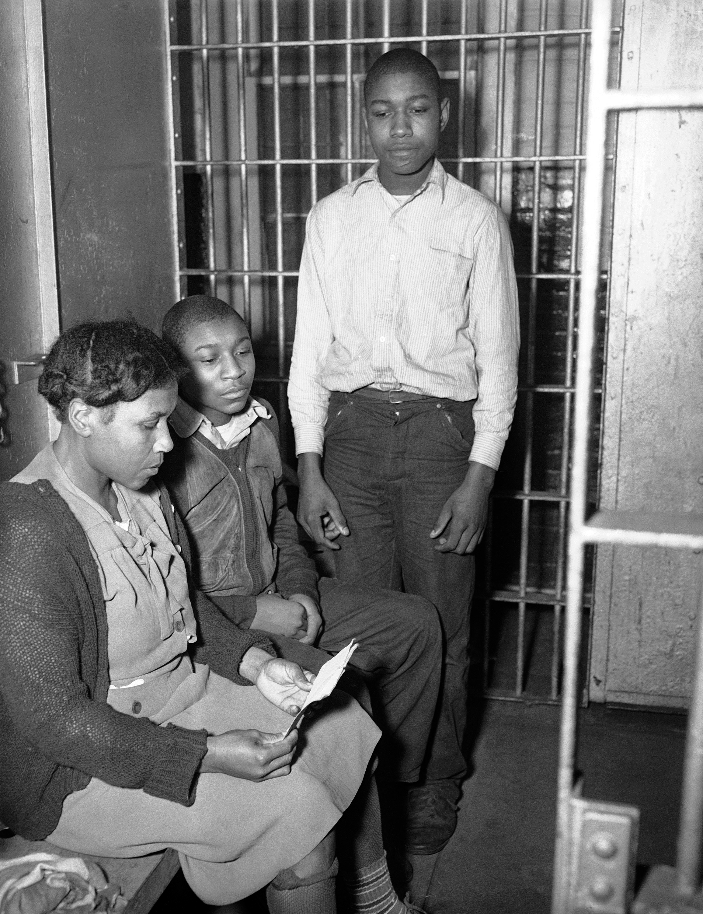 Figure 47. Rosa Lee Ingram and sons in jail cell, Albany, Georgia, March 3, 1948