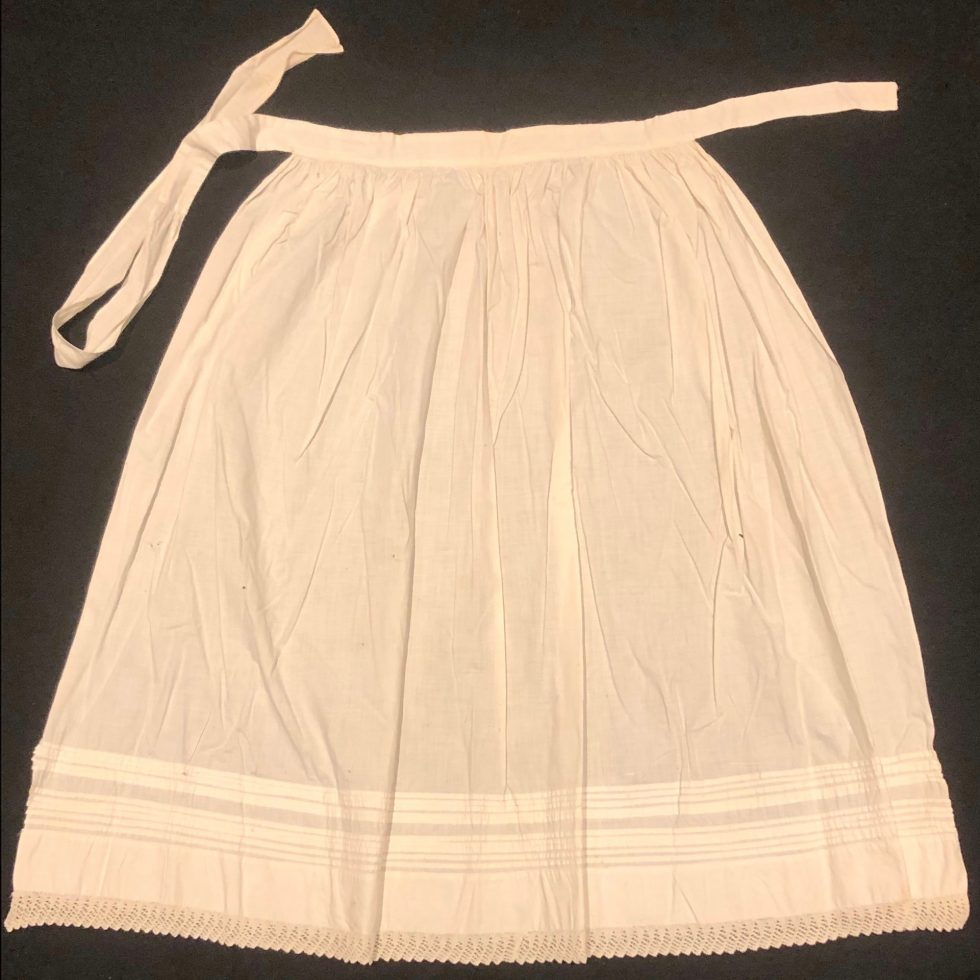 White Apron with pleated detail.