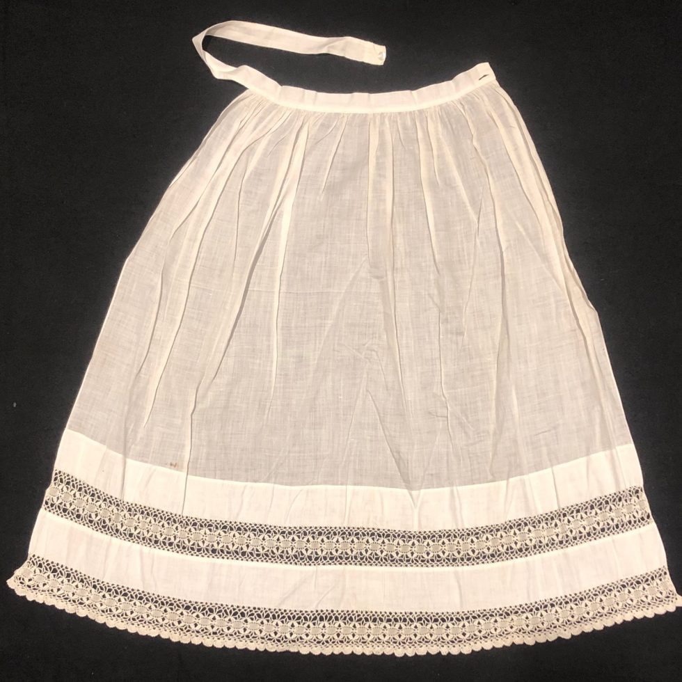 White Apron with lace detail.