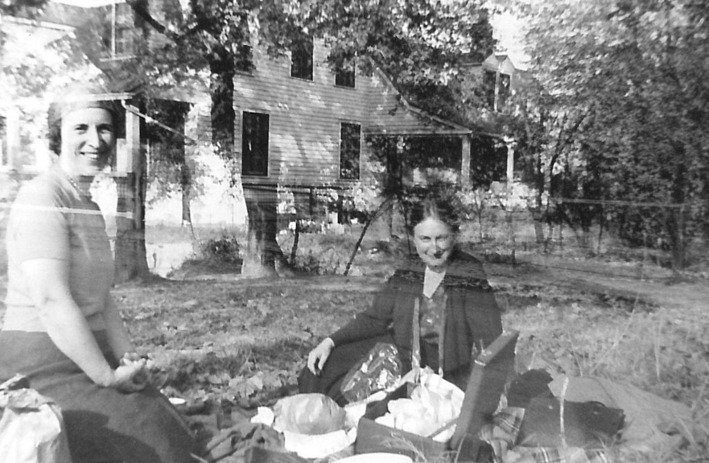 Black and white photo of two people having a picnic