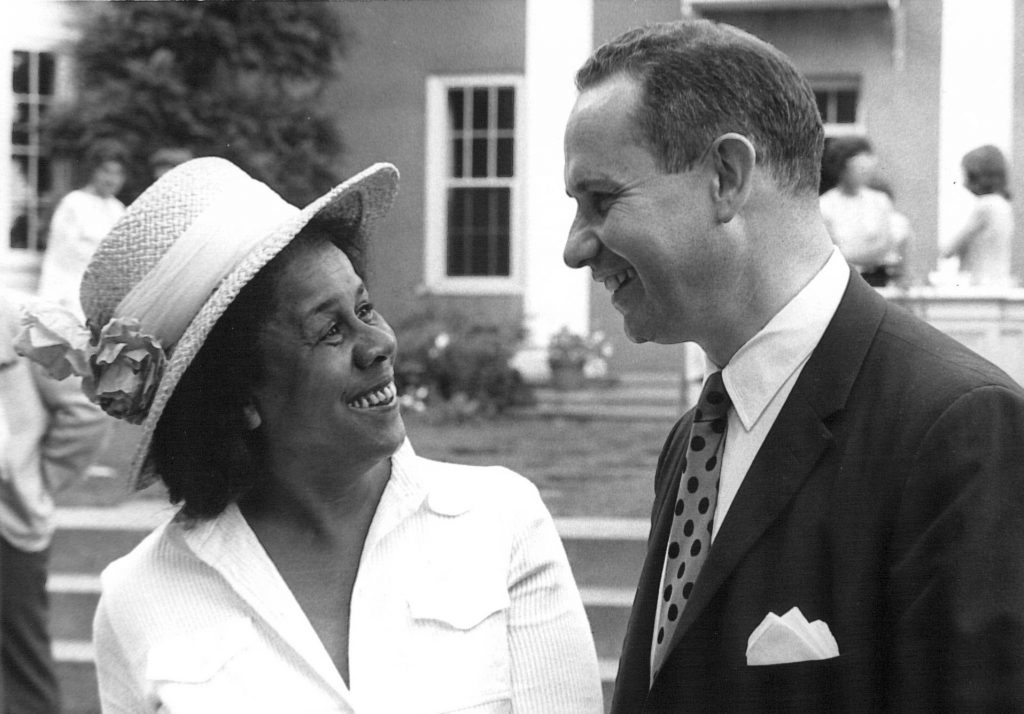 Black and white photo of Marie Singer and Howard Parad speaking