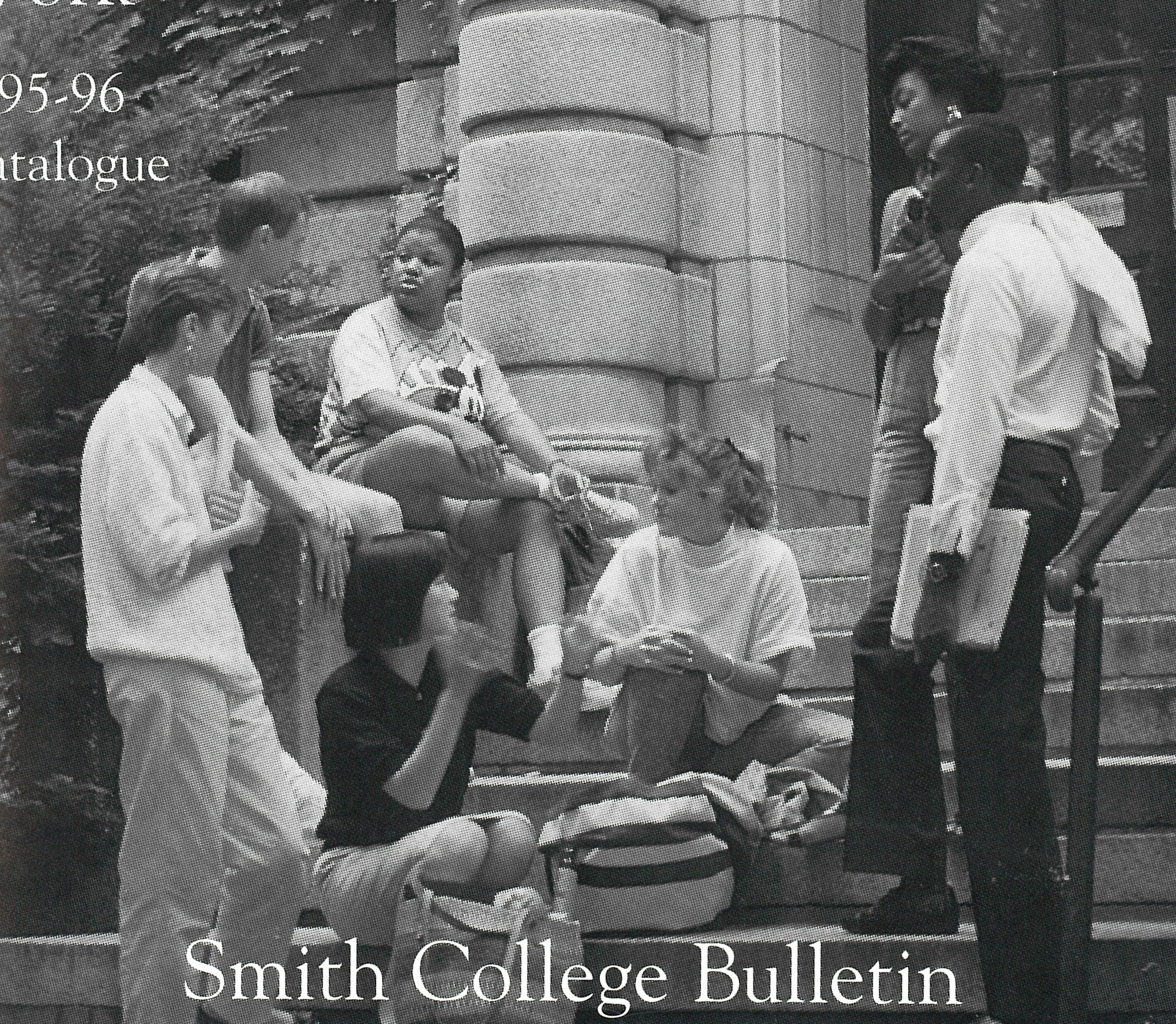 Black and white photo of interracial group of students on front steps.