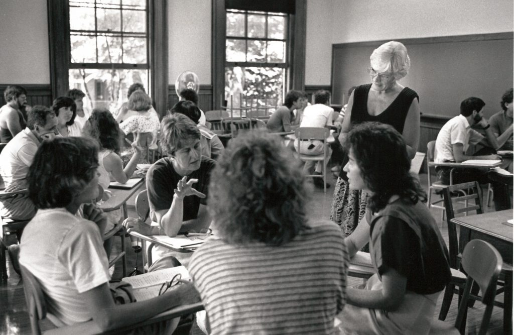 Black and white photo of 1980s classroom discussions