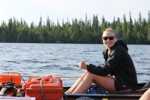 Author sitting in a canoe.